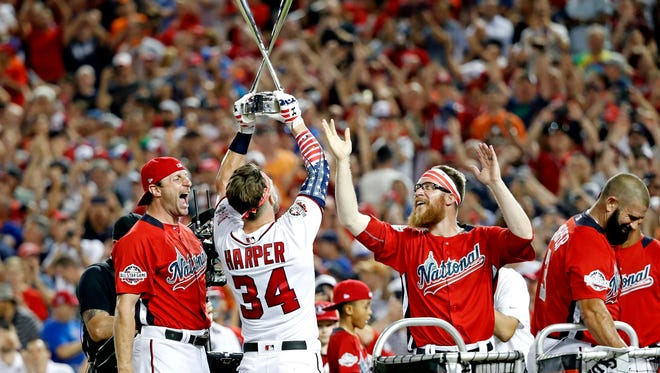 Jul 16, 2018: Washington Nationals right fielder Bryce Harper (34) celebrates with National League pitcher Max Scherzer of the Washington Nationals (31) and National League pitcher Sean Doolittle of the Washington Nationals (62) after winning the 2018 MLB home run derby at Nationals Ballpark.