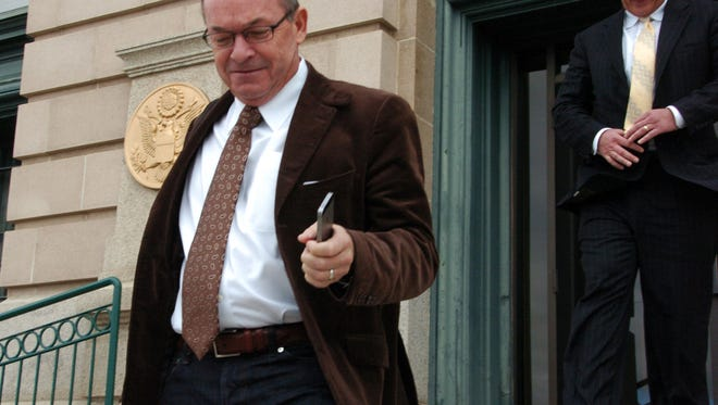 Tim Blixseth, left, leaves the U.S. courthouse in Butte, Mont., after facing questions about his finances. After almost six months in jail, Yellowstone Club founder Blixseth is due back in court Monday, Oct. 19, 2015, as he seeks to convince a federal judge that's he's come clean about the details of a disputed Mexican property sale.