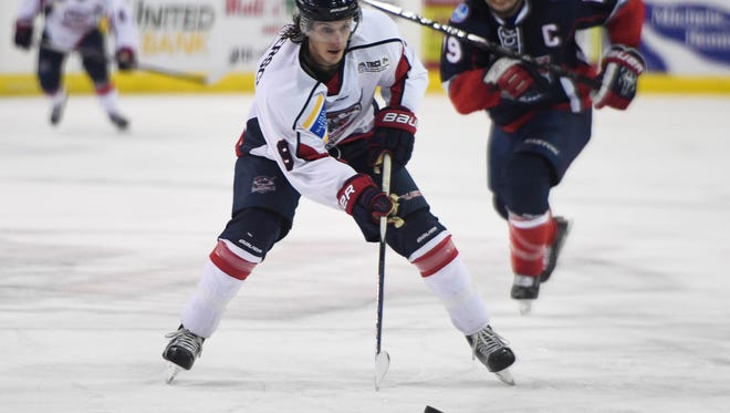 With defensive pressure from Mayhem's Matt Summers coming up from behind, Evansville Thunderbolt's Phil Bronner looks to pass as the Thunderbolts play the Macon Mayhem at the Ford Center Saturday, November 12, 2016.