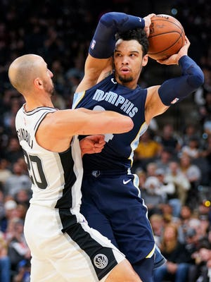 Memphis Grizzlies forward Dillon Brooks, right, looks to pass the ball past San Antonio Spurs guard Manu Ginobili during the second half of an NBA basketball game, Wednesday, Nov. 29, 2017, in San Antonio. San Antonio won 104-95. (AP Photo/Darren Abate)