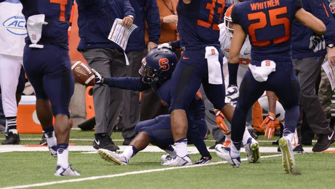In this 2015 photo, Syracuse Orange cornerback Juwan Dowels (15) shows the ball after making an interception during the third quarter of a game against the Clemson Tigers at the Carrier Dome.