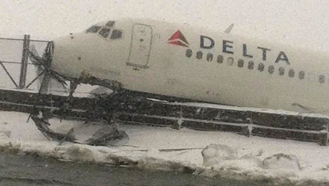 In this image released by the New York Fire Department, a Delta plane rests on a berm near the water at LaGuardia Airport in New York, Thursday, March 5, 2015. Delta Flight 1086, carrying 125 passengers and five crew members, veered off the runway at around 11:10 a.m., authorities said. Six people suffered non-life-threatening injuries, said Joe Pentangelo, a spokesman for the Port Authority of New York and New Jersey, which runs the airport. (AP Photo/New York Fire Department)