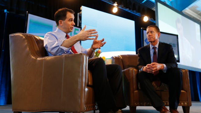 Wisconsin Gov. Scott Walker answers questions from Bruce Rastetter Saturday, March 7, 2015 during the Iowa Ag Summit in Des Moines.