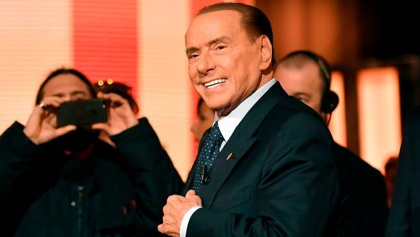 Former Italian prime minister Silvio Berlusconi arrives