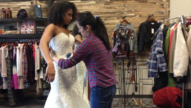 Fatima Bayram Sable fits model Simone Boone for Fashion Week. She is opening Silk Bridal Boutique Nov. 1.