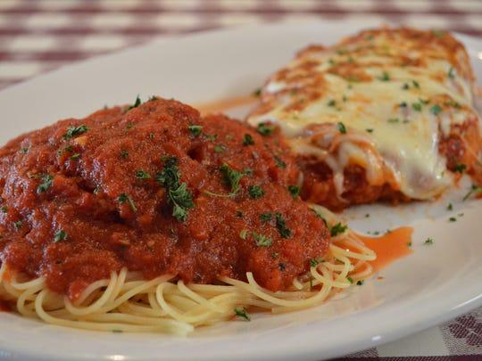 Pasta, sauce (or gravy) and chicken.
