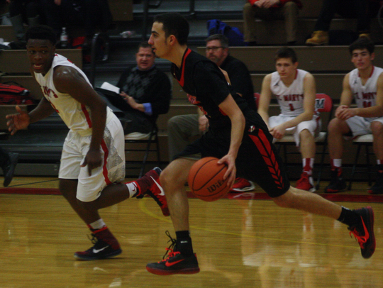 Canton's Hamoudy Turfe pushes the ball up court during