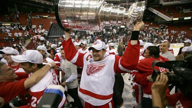 Detroit Red Wings defenseman Nicklas Lidstrom holds the Stanley Cup in 2008.
