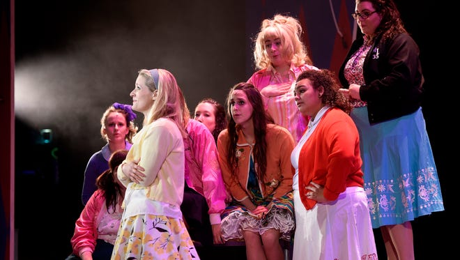 "Cast members gather around Kelly Zwick in the part of Sandy during a rehearsal of GREAT Theatre's production of ""Grease"" Monday, March 28, at the Paramount Theatre in St. Cloud."