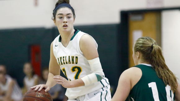 Lakeland's Colleen Walsh (12) controls a play during their 50-42 win over Brewster  in girls basketball action at Lakeland High School on Thursday, January 26, 2017.