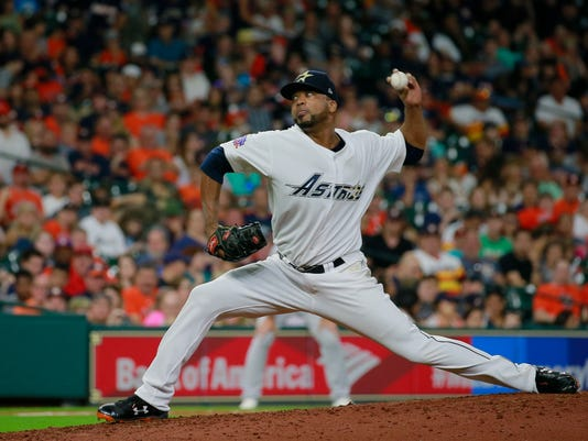 Houston Astros' Francisco Liriano takes over for starter Collin McHugh in pitching against the Oakland Athletics in the seventh inning of a baseball game Saturday, Aug. 29, 2017, in Houston. (AP Photo/Richard Carson)