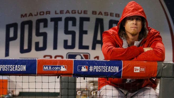 Jered Weaver sits in the rain following Game 3 of the ALDS on Oct. 5 in Kansas City, Mo. The Angels' 98-win regular season was reduced to rubble in three games last October by the Kansas City Royals. FILE - In this Oct. 5, 2014, file photo, Los Angeles Angels pitcher Jered Weaver (36) sits in the rain following Game 3 of baseball's AL Division Series in Kansas City, Mo. The Angels' 98-win regular season was reduced to rubble in three games last October by the Kansas City Royals, who return to Angel Stadium for the defending AL West champions' opener.  (AP Photo/Travis Heying, File)
