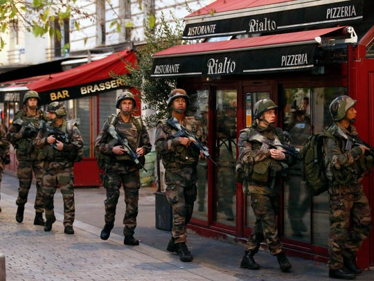 Soldiers operate in St. Denis, a northern suburb of