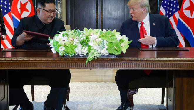 North Korea leader Kim Jong Un and President Donald Trump exchanged signed documents at the Capella resort on Sentosa Island in Singapore.