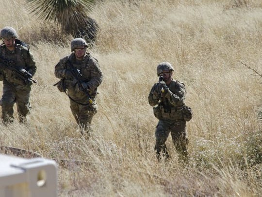 Solders shoot while pushing toward Mountain Village on White Sands Missile Range during the Vigilant Shield training exercise. The Soldiers were under heavy fire from an opposing force played by WSMR's security forces.