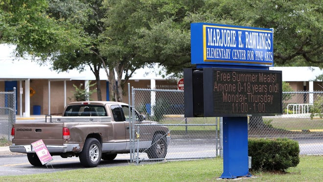 Marjorie K. Rawlings Elementary, pictured here in Gainesville on Wednesday, is one of eleven schools in the district that have students coming in for a summer reading camp. As state and local cases of COVID-19 are on the rise, about 350 students are coming back to 11 schools for summer school.