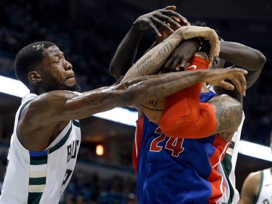 Bucks guard DeAndre Liggins (left) harasses Detroit's Eric Moreland during their game Wednesday.