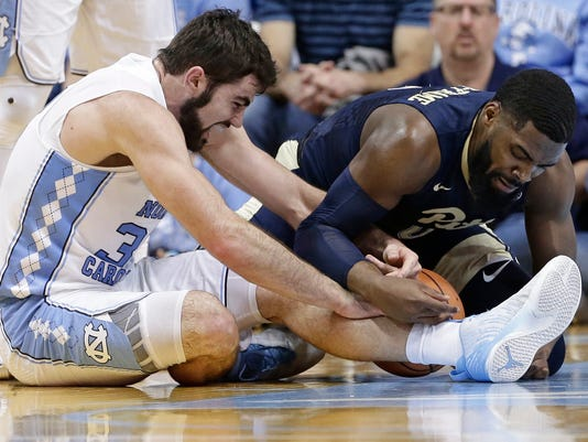 North Carolina's Sterling Manley, left, and Pittsburgh's Jared Wilson-Frame (0) struggle for possession of the ball during the first half of an NCAA college basketball game in Chapel Hill, N.C., Saturday, Feb. 3, 2018. (AP Photo/Gerry Broome)