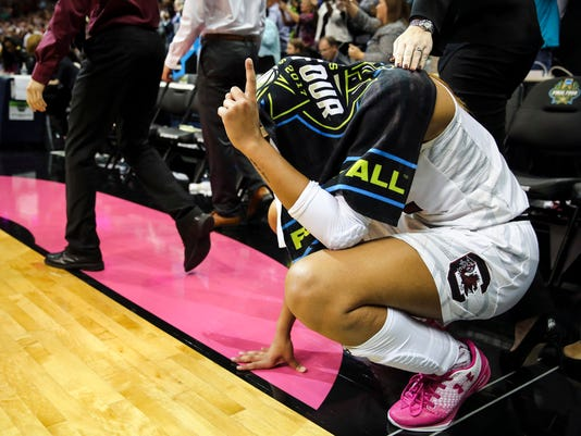 South Carolina forward A'ja Wilson (22) crouches and waves a finger as the final seconds tick down in the team's 67-55 win over Mississippi State in the NCAA women's college basketball tournament Final Four championship game in Dallas, Sunday, April 2, 2017. (Richard W. Rodriguez/Star-Telegram via AP)