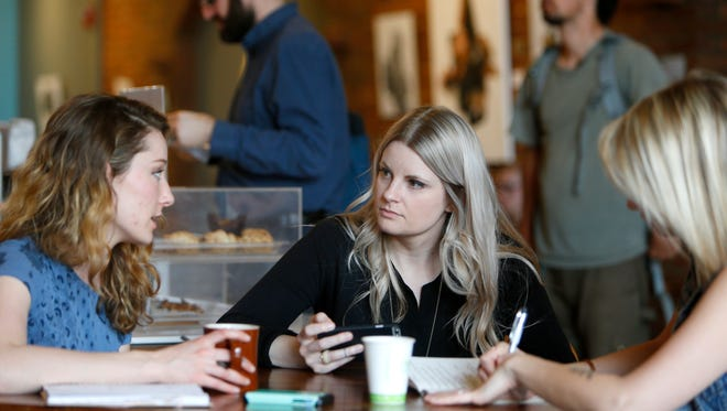 Founders of The Bravery Board Madison Hedlund (left), Kate Alsup (middle) and Michelle Houghton meet at the Coffee Ethic for their weekly meeting on Wednesday, March 23, 2016.