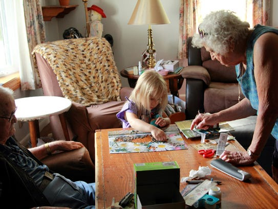 John and Emily Stephens work on a jigsaw puzzle with