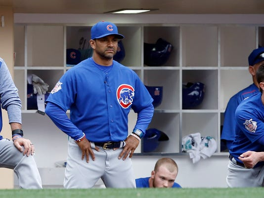 Chicago Cubs manager Joe Maddon, left, bench coach Dave Martinez and Kris Bryant, right, stare out from the dugout during the ninth inning of a baseball game against the San Diego Padres in San Diego, Wednesday, May 31, 2017. The Padres won 2-1 to sweep the three-game series. (AP Photo/Alex Gallardo)
