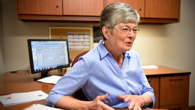 Ginny Kroll talks about her experiences during 50 years as a St. Cloud Area Chamber of Commerce employee Tuesday in her office in St. Cloud.
