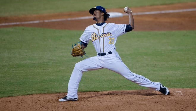 Biscuits pitcher Genesis Cabrera throws a pitch during the Montgomery Biscuits season home opener against the Biloxi Shuckers on Thursday, April 5, 2018.