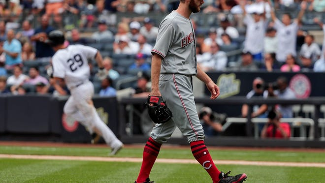 Cincinnati Reds relief pitcher Tony Cingrani reacts after giving up a solo home run to New York Yankees' Todd Frazier (29) during the seventh inning of a baseball game, Wednesday, July 26, 2017, in New York. (AP Photo/Julie Jacobson)