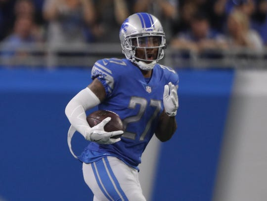 Lions safety Glover Quin runs back an interception