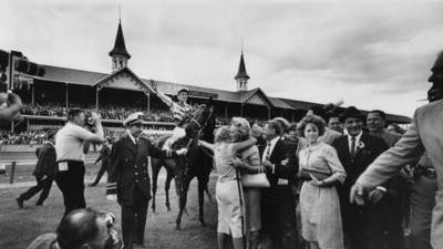 1961 Kentucky Derby winner Carry Back enters the winner's circle.