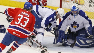 Amerks winger Joel Armia pounced on his own rebound and fired it past goalie Drew MacIntyre.