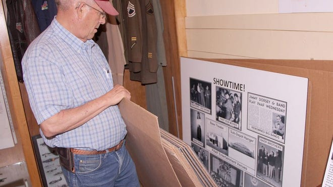 Museum volunteer George Stevens checks out storyboards with Pratt wartime history at the B-29 Museum.