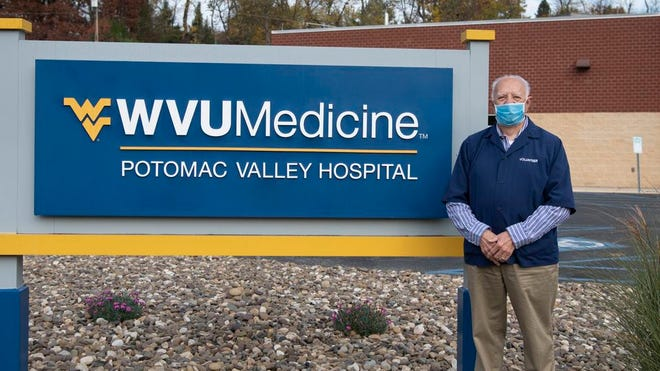 Pastor Paul Allen stands outside WVU Medicine Potomac Valley Hospital, where he ministers to patients as a pastoral care counselor.
