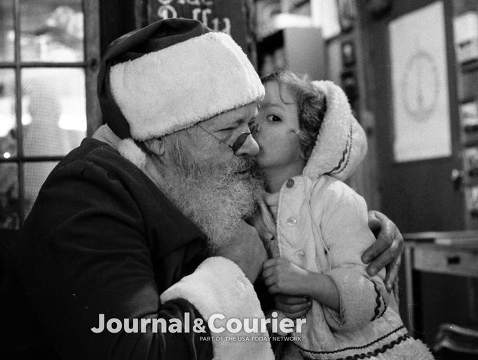 Four-year-old Jeannie Gibson of Lafayette whispers