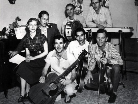 In a 1953 photo, Jean Shepard, left, appears with Bill Woods, Johnny Cuviello and Fuzzy Owens on the back row. On the front row, from left to right are Gene Breeden, Lewis Talley and Jelly Sanders.