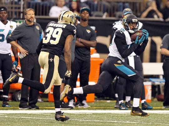 Jacksonville Jaguars wide receiver Allen Robinson (15) catches a 90-yard touchdown pass while defended by New Orleans Saints cornerback Brandon Browner (39) in the second half at the Mercedes-Benz Superdome.