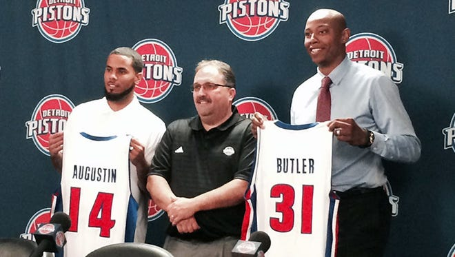 New Pistons D.J. Augustin, left, and Caron Butler flank new coach and team president Stan Van Gundy.