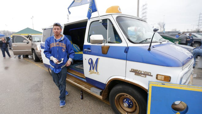 Josh Stanelle of Slinger gets out of his Milwaukee Brewers van before his team faced the Colorado Rockies on opening day at Miller Park on Monday.