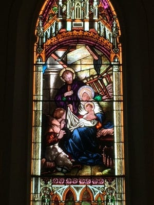 Christmas window of the former St. Patrick's church, Praise Assembly of God.