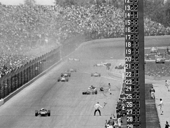 In this May 31, 1967, file photo, AJ Foyt, foreground
