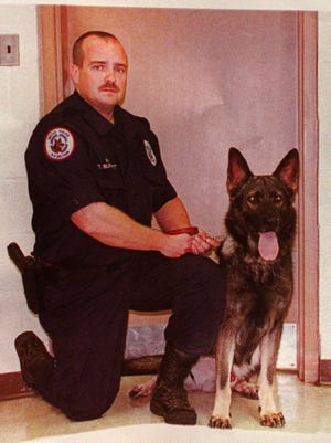 "Metro Officer Terry Burnett's dog Aron was killed by a bank robber in 1998. ""What (Aron) did saved police officers' lives,"" Burnett said."