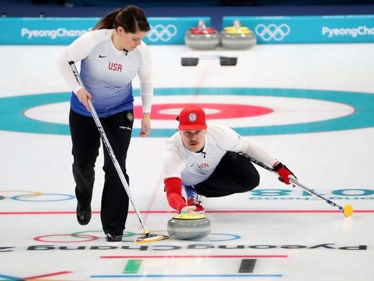 Becca Hamilton and Matt Hamilton compete in the curling