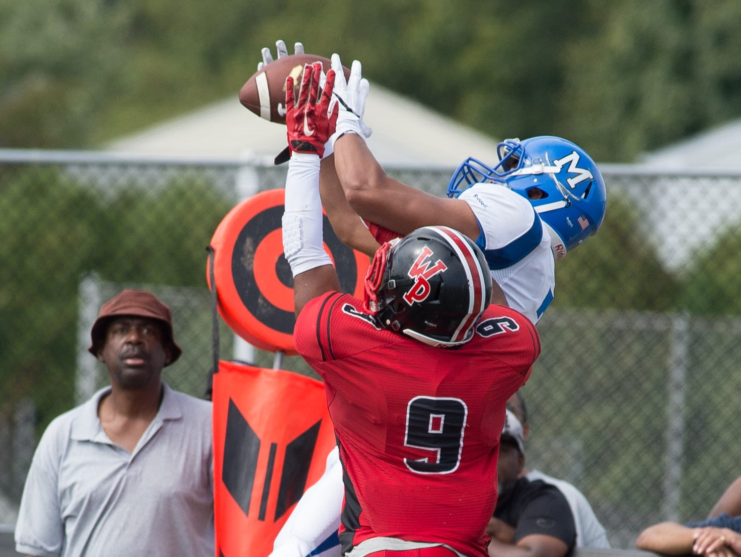 Middletown's Kenneth Edelin (7) catches a ball near the goal line as William Penn's Isaiah Gaynor (9) defends.