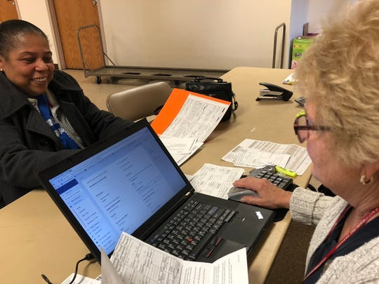Deborah Hallock, a tax preparer for AARP's TaxAide program, works on taxes for Ella Kelley, Chambersburg, the morning of Monday, April 16 at the recreation center in Chambersburg. All taxes need to be completed and filed by Tuesday, April 17.