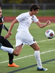 Novi's Hernan Brarda (right) pushes the ball ahead