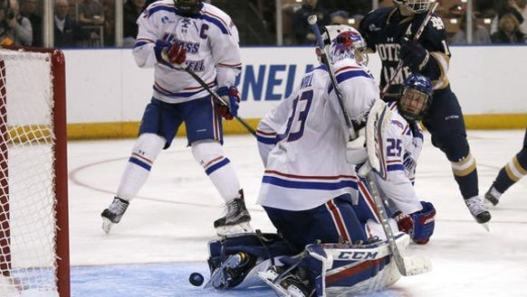 Massachusetts-Lowell's Dylan Zink (25) and Michael