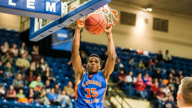 Former Byrd star A.J. Gaines Jr. finishes a slam in Saturday's NABC Division III All-Star Game in Virginia. Gaines completed a stellar career at Louisiana College.