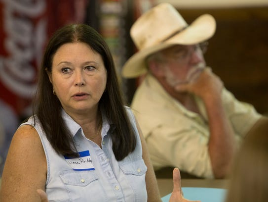 Liesa Priddy speaks at a get together for ranchers