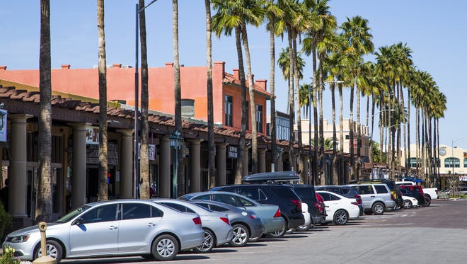 Palm-lined sidewalks connect popular shops, restaurants and bars at West Boston Street and South San Marcos Place in downtown Chandler, Monday, March 13 2017.